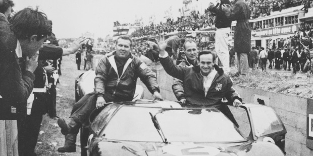 Chris Amon, right, waves to the crowd from his 7-litres Ford automobile after he and compatriot Bruce McLaren won the 24-hours endurance for sports cars, at Le Mans. Photo / AP