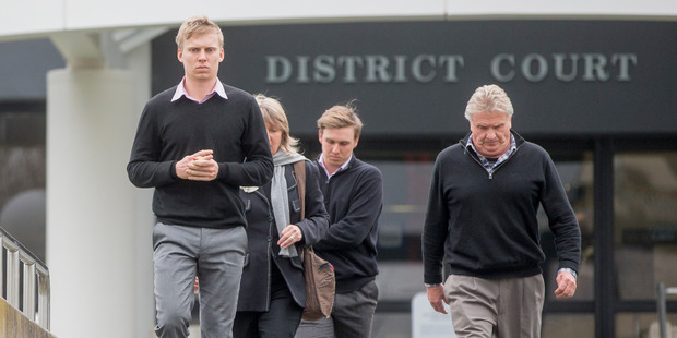 Northern Districts cricketer Scott Kuggeleijn (left) leaves the Hamilton District Court with his family. Photo / Mike Scott