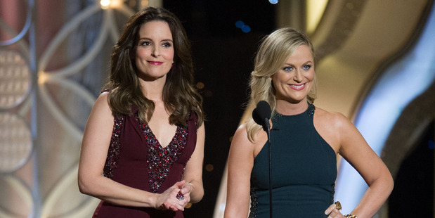Hosts Tina Fey and Amy Poehler on stage during the Golden Globe Awards.