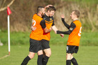CELEBRATION TIME: Mitchell Miller, centre, is congratulated by his team-mates after scoring for his side. PHOTO/FILE