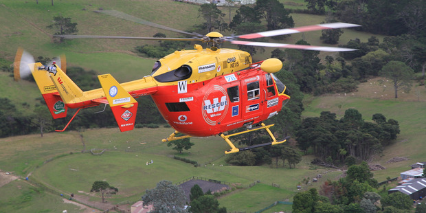 The woman was flown to Auckland City Hospital in a serious condition. Photo / Auckland Rescue Helicopter Trust