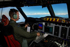 Royal New Zealand Air Force Flight Lieutenant co-pilots the P-3K2 Orion in support of the Australian Maritime Safety Authority led search for Malaysia Airlines MH370. Photo / AP