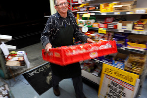 MORNING CHORES: Alan Young carries trays of bread into the shop soon after opening the doors at 6am. PHOTO/JOHN STONE