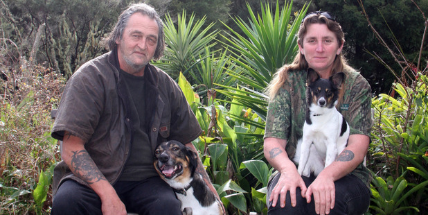 Pete Roy with Max and Angela Rose-Collins with her dog Roxy. PICTURE/DANIELLE COLLINGS
