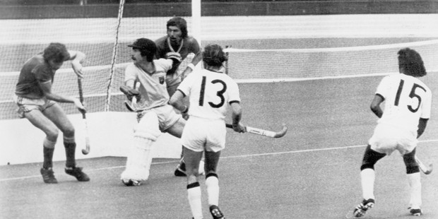 New Zealand striker Ramesh Patel (No15) sees his shot knocked over the bar by Australian goalie Robert Proctor in the gold medal hockey match at the 1976 Montreal Olympics. Photo / AAP