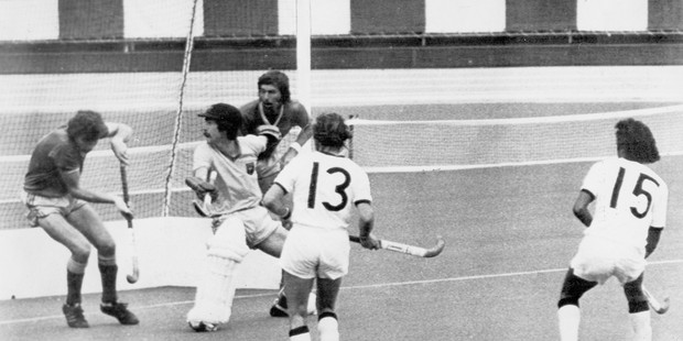Loading New Zealand striker Ramesh Patel (No15) sees his shot knocked over the bar by Australian goalie Robert Proctor in the gold medal hockey match at the 1976 Montreal Olympics. Photo / AAP