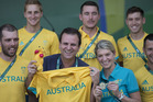 Rio de Janeiro's mayor Eduardo Paes, left, poses for photos with Australia's delegation head Kitty Chiller, right. Photo / AP