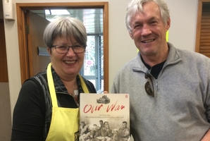 Sue Ogle, president of Zonta Hatea, with author Martyn Thompson who found a copy of the book he wrote.