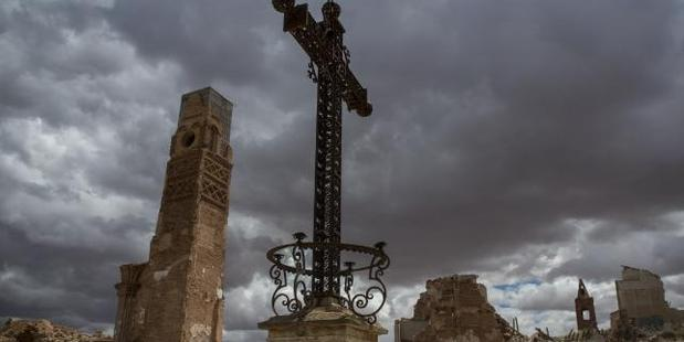The metal cross in the main square in the old village of Belchite near Zaragoza in Spain, which remains a ghost town as a memorial to the civil war. Photo / Ella Pellegrini, News Corp