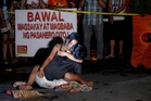 The image of Jennilyn Olayres cradling the body of her dead husband, Michael Siaron, has captured the human cost of Rodrigo Duterte's drug war. Photo / AFP