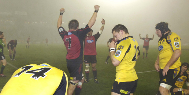 The Crusaders celebrate their win after the fogbound Super 14 rugby final against the Hurricanes at Jade Stadium.