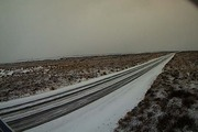 Traffic cameras show a light dusting of snow on the Desert Rd summit.