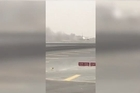 Cell phone footage captured the Dubai-based airline Emirates bursting into flames after it crash-landed at Dubai's main airport Wednesday. Officials say there were 300 people aboard the jetliner, and all passengers and crew are safe