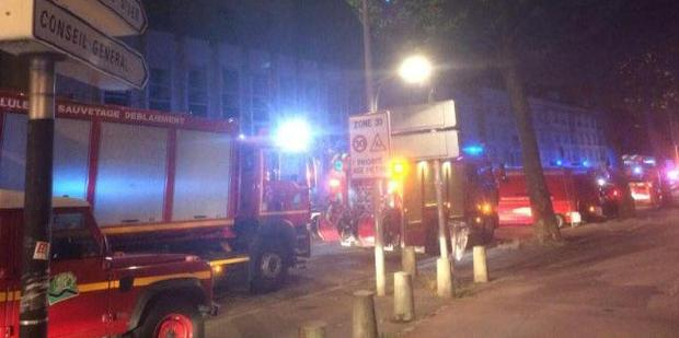 Police and fire services outside the scene of the Rouen bar fire. Photo / Twitter