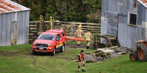 Loading Firefighters arrive at the Welcome Bay farm where a person has been found dead after a four-wheel drive vehicle rolled. Photo/George Novak