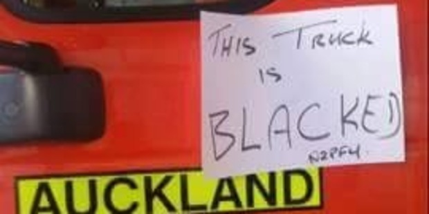 The note on the 'blacked' fire truck.