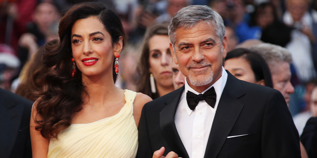 It seems someone like George Clooney, whose wife is human rights lawyer Amal, is the exception rather than the rule. Photo / AP