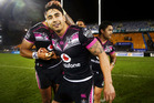 Shaun Johnson of the Warriors is mobbed by teammates after scoring a golden try. photo / Getty