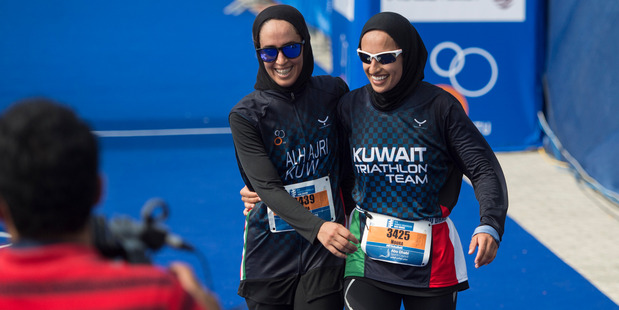 Nada Aljeraiwi, left, and Noura Al Hajeri share a laugh after completing in the ITU World Triathlon Abu Dhabi, United Arab Emirates earlier this year. Photo / Nikki Kahn