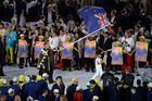 Peter Burling carries the flag of New Zealand during the opening ceremony for the 2016 Summer Olympics in Rio de Janeiro. Photo / AP