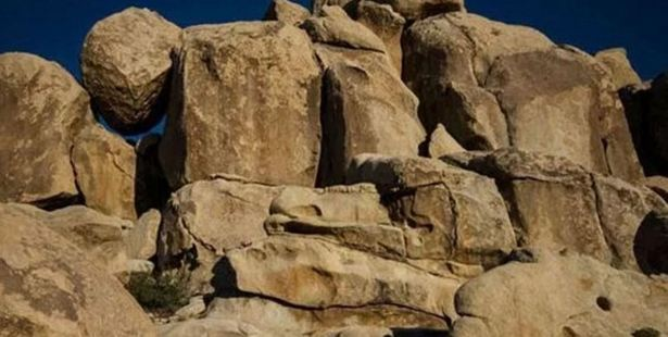 Somewhere amid the boulders is a little girl waving to the camera. Photo / Imgur