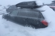 A snow-covered car in the Whakapapa skifield carpark this morning. Photo / Gene Tomlinson
