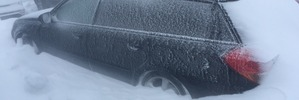 Snow closes roads, forces evacuations
