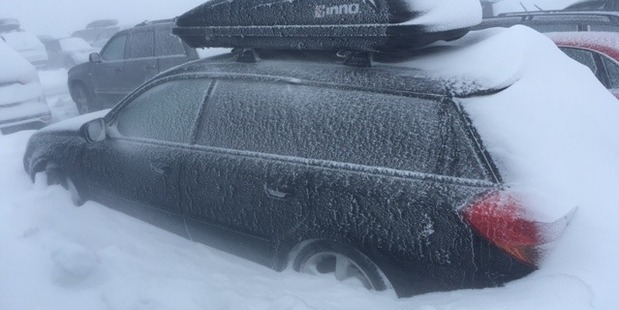 Loading A snow-covered car in the Whakapapa skifield carpark this morning. Photo / Gene Tomlinson