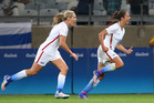 United States' Carli Lloyd, right, celebrates after scoring against New Zealand at the Rio Olympics. photo / AP