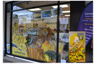 BRIGHT DISPLAY: The Cancer Society Shop window with (inset) Daffodil Day merchandise. PICTURE / PAUL BROOKS