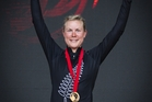 Linda Villumsen celebrates with her gold medal after winning the women's time trial at Glasgow CR time trial course. Photo / File