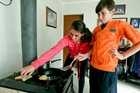 Alexandra, 11 (left) and Emmet Mackintosh, 9, say cooking on the fireplace is the best thing about the outage. Photo / NZME