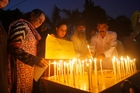 Civil society activists in Peshawar pay tribute to the victims of the bombing in Quetta. Photo / AP