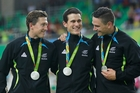 New Zealand silver medallists, from left, Ethan Mitchell, Sam Webster and Eddie Dawkins on the podium at the Rio Olympic Velodrome. Picture / AP