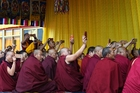 Tibetan monks take  cellphone pictures during the Kalachakra ritual in Xigaze, southwest China's Tibet Autonomous Region. Picture / AP