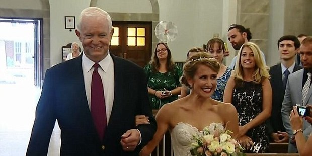 Arthur Thomas was honoured to walk Jeni Stepien down the aisle. Photo / KDKA