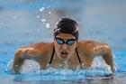 Olympic refugee team member Yusra Mardini swims practice laps at the Olympic Aquatics Stadium. Photo / AP