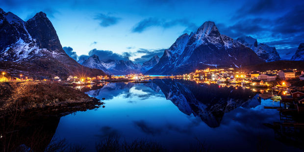 Sunset in Reine, a village on Norway's Lofoten Islands. The remote destination north of the Arctic Circle has been overrun with tourists since 'Frozen' became a global blockbuster. Photo / 123RF