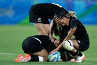New Zealand's Tyla Nathan-Wong, right, and her teammates are overcome with emotion after losing the women's sevens final. Photo / AP
