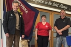 Tony Haslett (left), Hawke's Bay area manager for Fonterra, presents the first 25kg bag of milkpowder to Lynda Ellington, mission director of the Dannevirke Salvation Army and dairy farmer Craig Bishop.