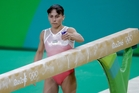 Oksana Chusovitina prepares the balance beam for her routine during the artistic gymnastics women's qualification in Rio. Photo / AP