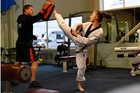 Brooklyn Storey, with Taekwondo New Zealand development officer Tim Urquhart, is in Rio to support New Zealand's sole representative in the sport at the 2016 Olympics, Andrea Kilday. Photo/File