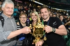 Richie McCaw and partner Gemma Flynn celebrate the winning of the Rugby World Cup with family. Photo / Photosport