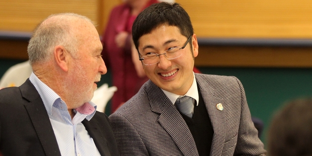 Hawke's Bay regional councillor Rex Graham speaks to James Yuming Guan, the winner of the Best Asian Practising Professional Award at last night's awards. Photo / Duncan Brown
