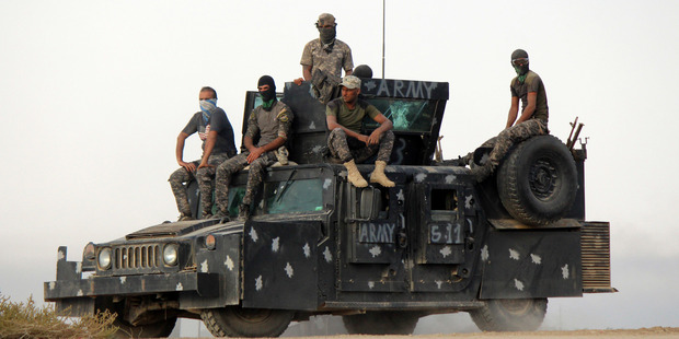 Iraqi security forces backed by allied Shia Popular Mobilisation forces and Sunni tribal fighters prepare to attack Isis positions at Khalidiya Island in Anbar province, Iraq. Photo / AP