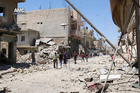 Syrian citizens in damaged streets after airstrikes hit Aleppo. Photo / Aleppo Media Centre, AP