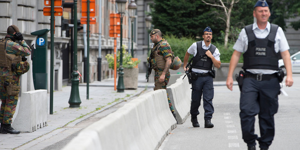 Police and soldiers from the Belgian Army secure an area in front of the Belgian Prime Minister's office. Photo / AP
