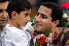 In this July 15, 2010 photo, Shahram Amiri, an Iranian nuclear scientist greets his son Amir Hossein as he arrives in Tehran after returning from the United States. Photo / AP