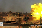 A tank being used by Syria's al-Qaeda-linked Nusra Front fires at Syrian troops in southern Aleppo. Photo / AP