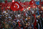 A Turkish woman waves a flag of her country during the speech of President Recep Tayyip Erdogan at the Democracy and Martyrs' Rally in Istanbul. Photo / AP